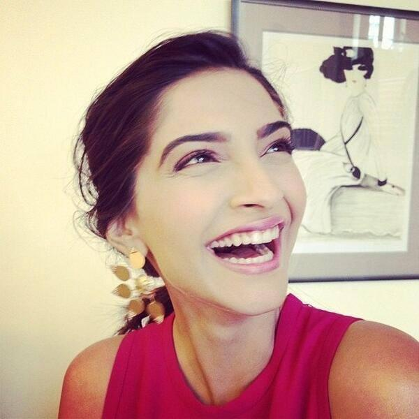Sonam Kapoor Cool Laughing Look At The Press Meet Of Cannes 2014