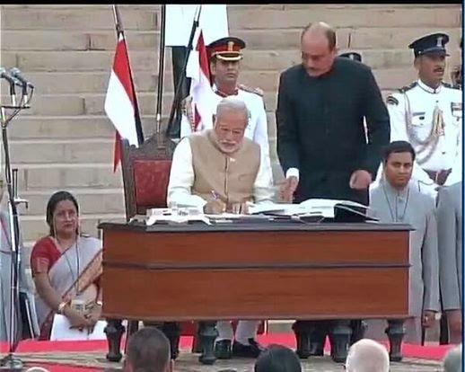 Narendra Modi Signed The Register During The Oath Taking Ceremony Of 15th Prime Minister Of India