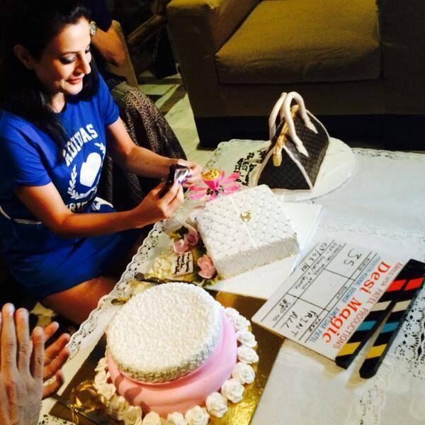 Ameesha Patel Cutting A Cake On The Sets Of Desi Masic