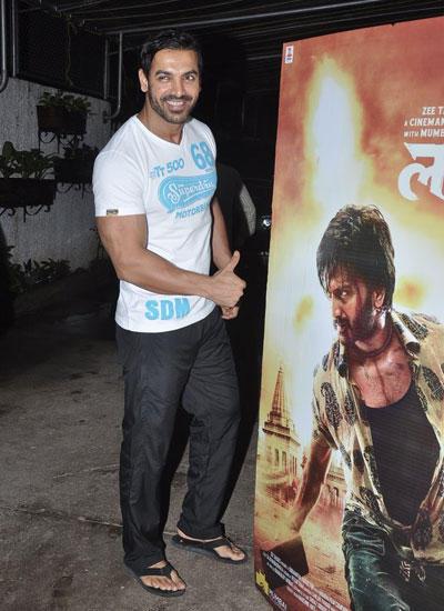 John Abraham Posed Infront Of Lai Bhaari Movie Poster At The Screening Of Lai Bhaari