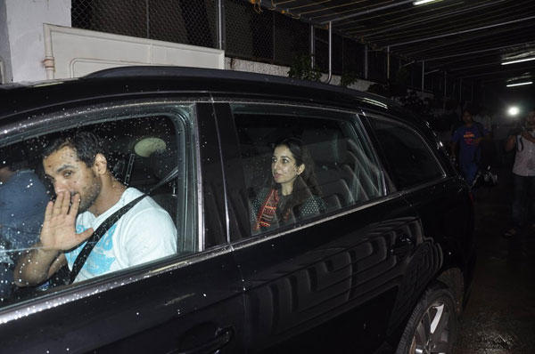 John Abraham Wave His Hand For Fans Inside The Car At The Screening Of Lai Bhaari Movie