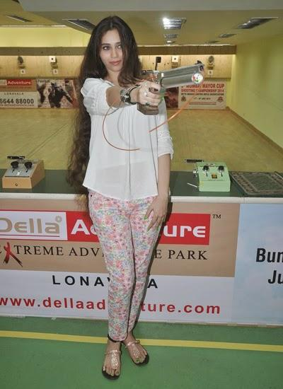 Sasha Agha Posed With Gun For Camera  During The Promotion Of Desi Kattey At Mumbai Mayor Cup Shooting Competition 2014