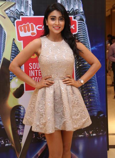 Shriya Cute Pose Photo Shoot At SIIMA Curtain Raiser Press Meet
