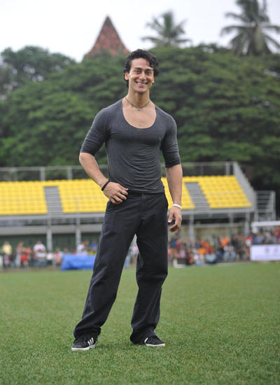 Tiger Shroff Smiling Pose In The Field At Ira Khan Organised Charity Football Match 2014