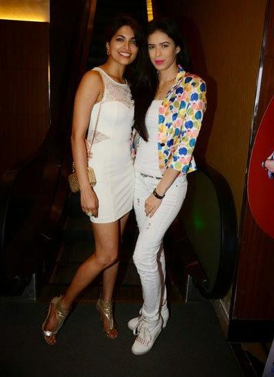 Parvathy And Sucheta Posed For Camera At Pizza 3D Special Screening Party Host By Parvathy Omanakuttan