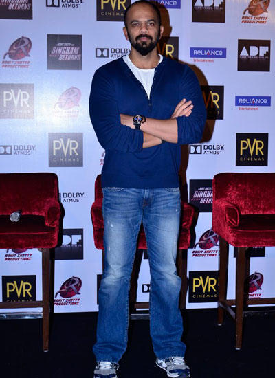 Rohit Shetty Strikes A Pose During The Launch Of Merchandise For Singham Returns