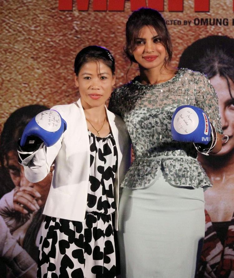 Mary Kom Movie Music Launch Event Priyanka And Mary Pose With Boxing Gloves