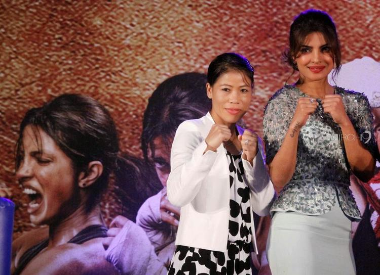 Priyanka And Mary Kom Strikes A Boxing Pose During The Launch Of Mary Kom Music