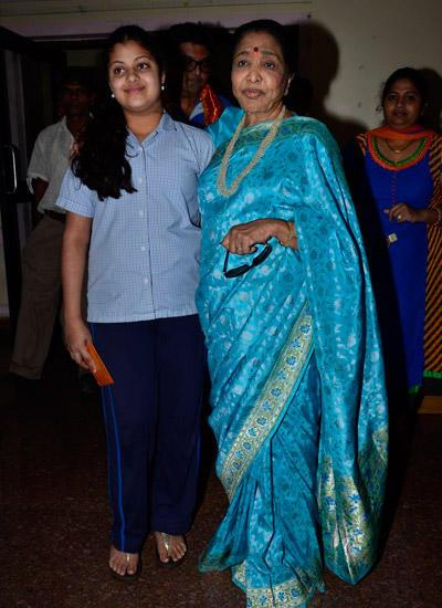 Asha Bhosle With Her Grand Daughter During The Bappa Moraya Album Launch At IMFAA