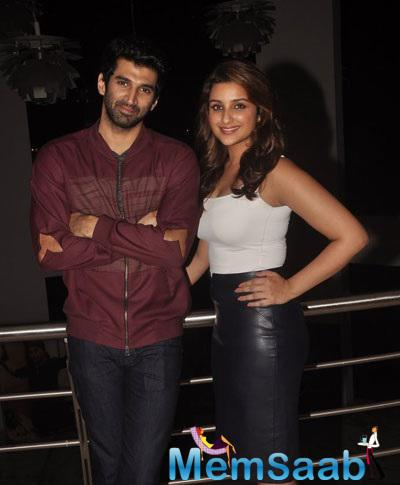 Aditya Roy Kapur And Parineeti Chopra Posing For Shutterbugs