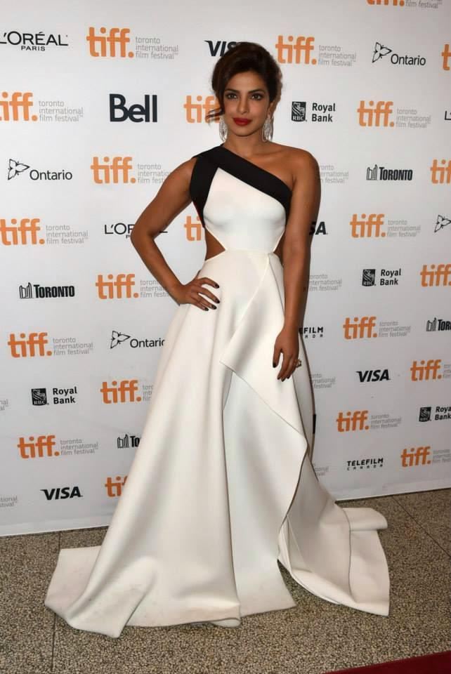Priyanka Poses In A Lovely White Gown As She Arrives For The Premiere Of The Film 'Mary Kom' At The TIFF In Toronto