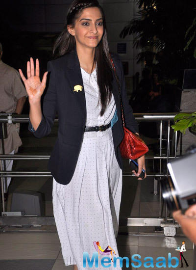 Sonam Kapoor Waves Hand For Fans At Mumbai International Airport
