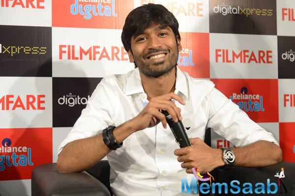 Smiling Dhanush Addresses The Media At The Filmfare Readers Meet In Reliance Digital Store