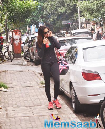 Bipasha Basu Busy With A Phone After A Workout In Mumbai