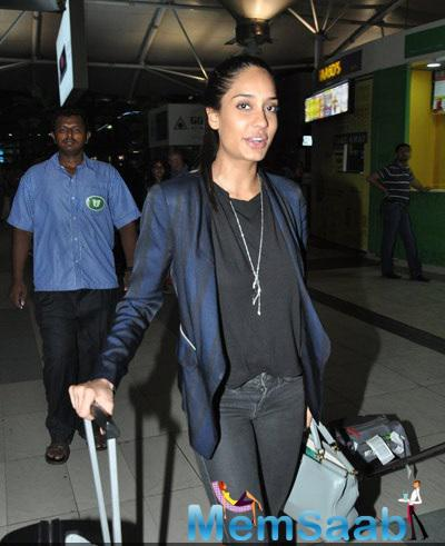 Lisa Haydon Strikes A Pose At Domestic Airport In Mumbai With Her Luggage