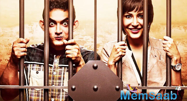 PK Poster Aamir Khan And Anushka Sharma Are In A Jail