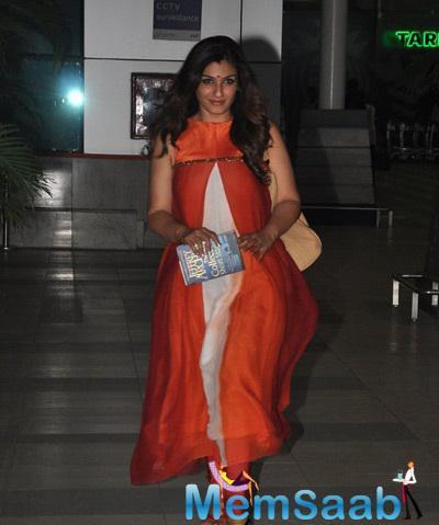 Raveena Tandon Snapped At Mumbai International Airport With A Book