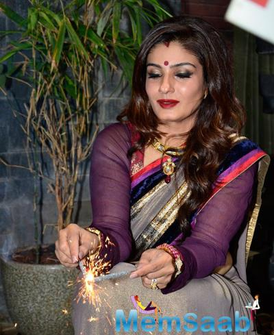 Raveena Tandon Played With Sparkles At Her Residence During Diwali Celebrations