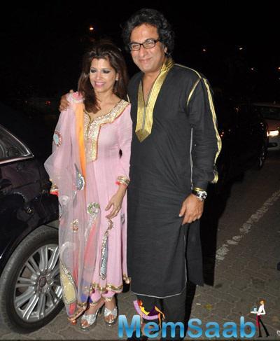Talat And Bina Aziz Pose For The Media At Vardan Aashirwad House Party