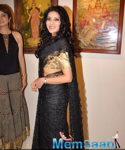 Nandana Sen Ravishing Look In Black Saree At Cosmic Heart Exhibition