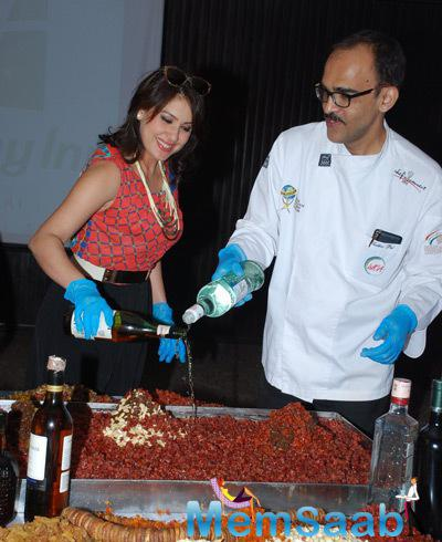 Actress And Model Amrita Raichand Participated In Cake Mixing Event