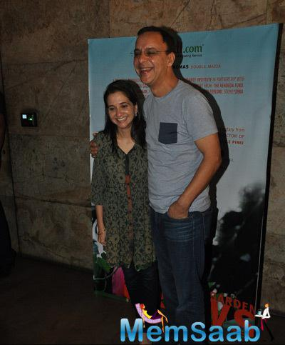 Anupama Chopra And Hubby Vidhu Vinod Chopra Smiling Pose At The Screening Of Documentary Movie Hosted By Aamir Khan