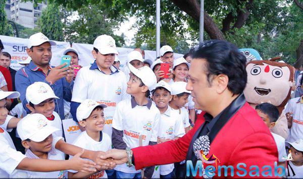 Govinda Meets The Kids At The Surya Sunshine Walkathon 2014
