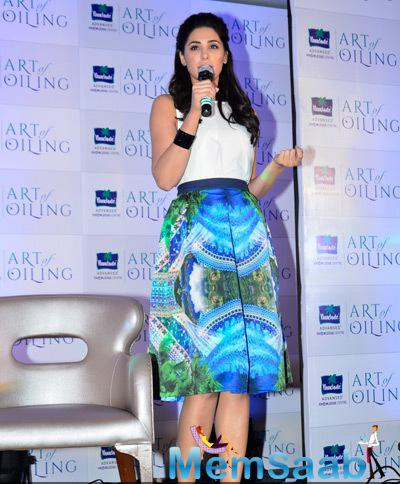 Nargis Fakhri Addresses The Media During The Launch Of Parachute Signature Line Art Of Oiling