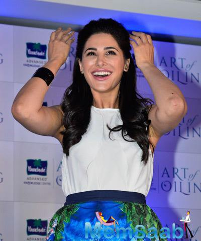 Nargis Fakhri Cool Laughing Pose At The Launch Of Parachute Signature Line Art Of Oiling