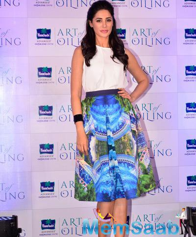 Nargis Fakhri Strikes A Pose For Camera During The Launch Of Parachute Signature Line Art Of Oiling