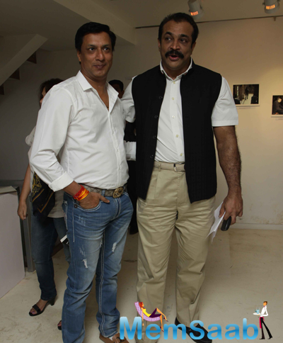 Madhur Bhandarkar And Himanshu Roy Posed During The Launch Of Sandeep Unnithan Book Black Tornado