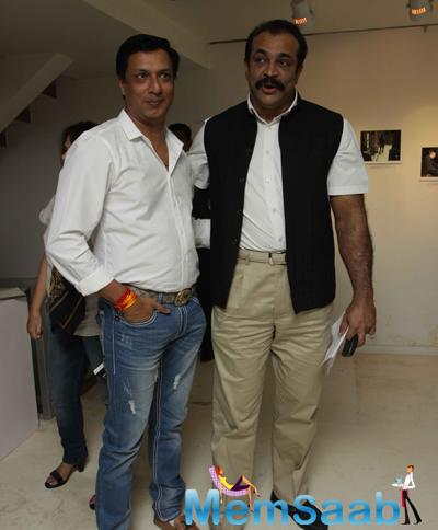 Madhur Bhandarkar And Himanshu Roy Posed During The Launch Of Sandeep Unnithan Book Black Tornado