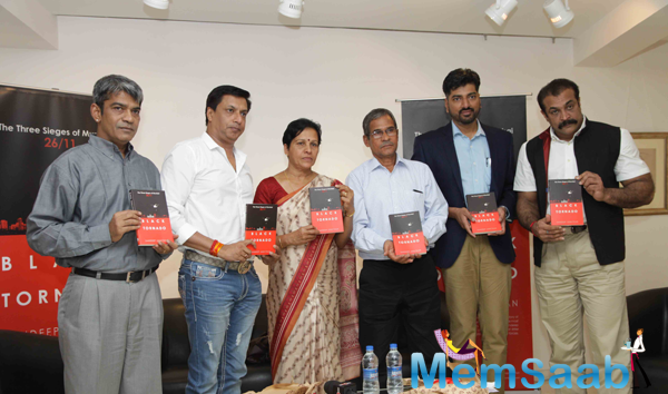 Madhur Bhandarkar And Others Posed With Book During The Launch Of Sandeep Unnithan Book Black Tornado