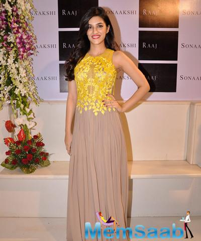 Kriti Sanon Looked Pretty In A Bright Yellow And Brown Gown At The Launch Of Sonaakshi Raaj Flagship Store
