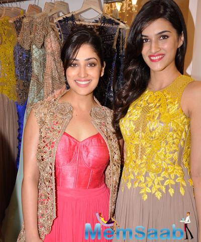 Yami Gautam And Kriti Sanon Smiling Pose During Sonaakshi Raaj Flagship Store Launch