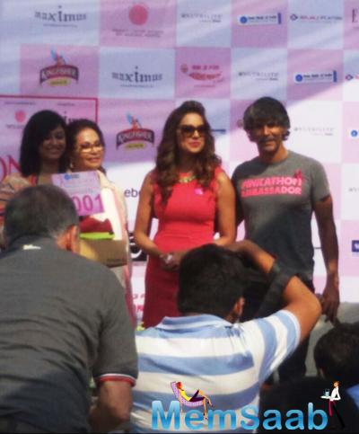 Bipasha Basu And Milind Soman Posed For Camera During The Pinkathon Press Meet