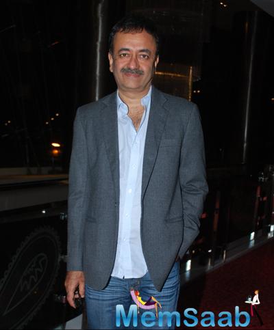 Rajkumar Hirani Posed For Camera During The PK Movie Press Meet