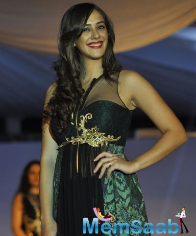 Hazel Keech Flashes Smile On Ramp At The Global Peace Initiative 2014