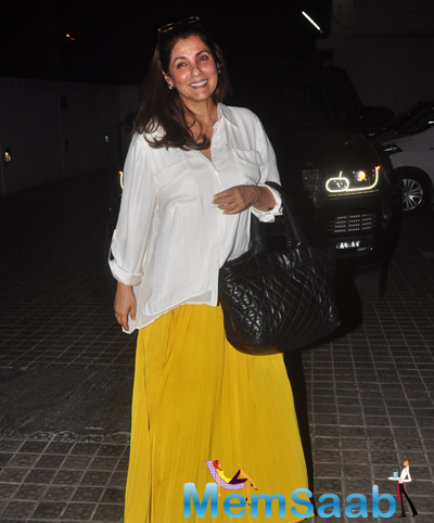 Dimple Kapadia Seen In Yellow Skirt And White Top At PVR