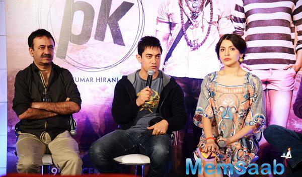 Aamir khan Interacts With Media,Rajkumar Hirani And Anushka Sharma Look On During The Press Meet Of PK Movie
