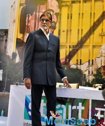 Amitabh Bachchan Strikes A Pose During The Inaguration Of Dada Saheb Phalke Painting