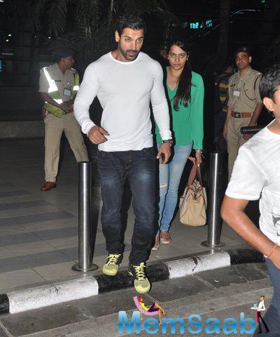 John Seen With His Wife Priya At Mumbai International Airport