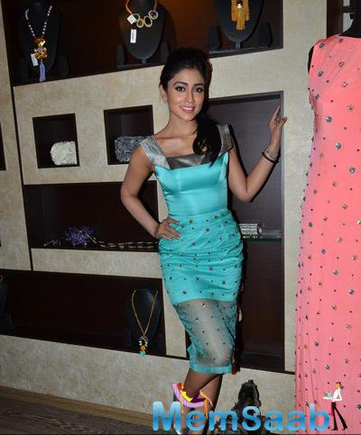 Shriya Saran Cool Pose At The Launch Of Rajat Tangri New Dress Collection
