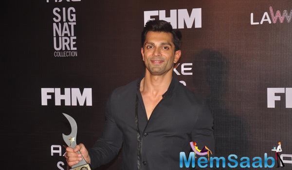 Karan Singh Grover Posed With Trophy At Axe Signature And FHM Bachelor Of The Year 2014 Awards