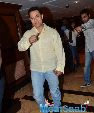 Aamir Khan Strikes A Cool Pose During PK Contest Winner Meet