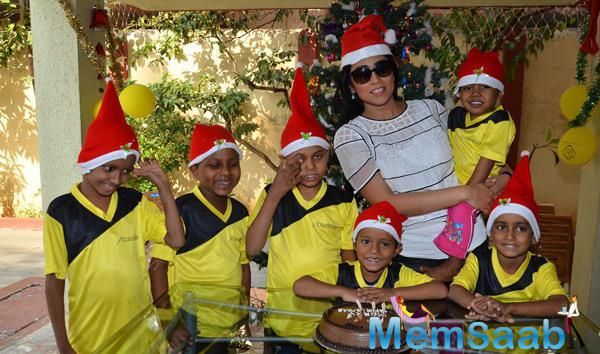 Shriya Saran Gifted NGO Kids Santa Caps And Sweets