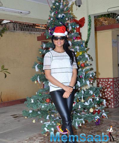 Shriya Saran Strike A Pose For Shutterbugs With Christmas Tree At NGO