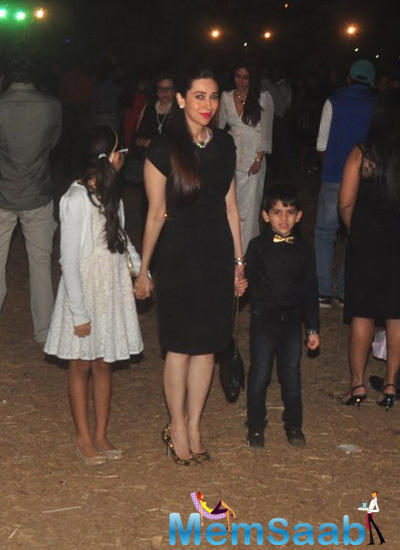 Karisma Kapoor Snapped At Midnight Mass With Her Kids