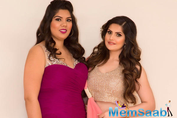 Zareen Khan And Amita Bal Strike A Pose For Shutterbugs At Christmas Gala Event