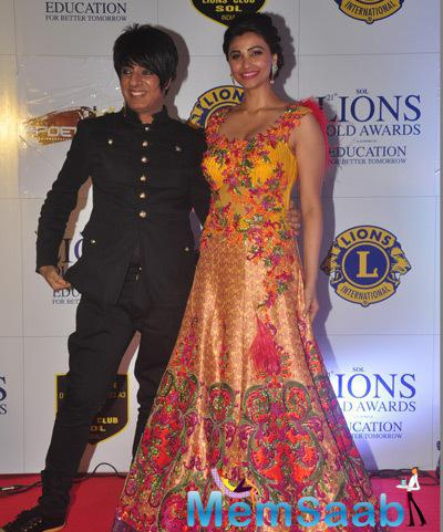 Designer Rohit Verma And Actress Daisy Shah Strike A Pose For Shutterbugs At 21st Lions Gold Awards